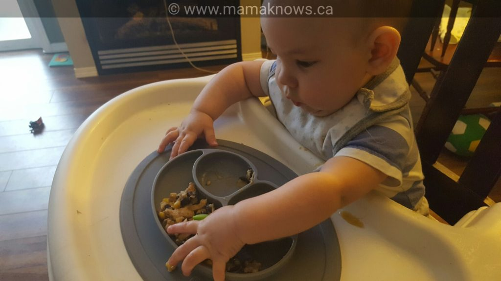 Ez pz mini Mat fits on the high chair tray and has 3 sections for baby food