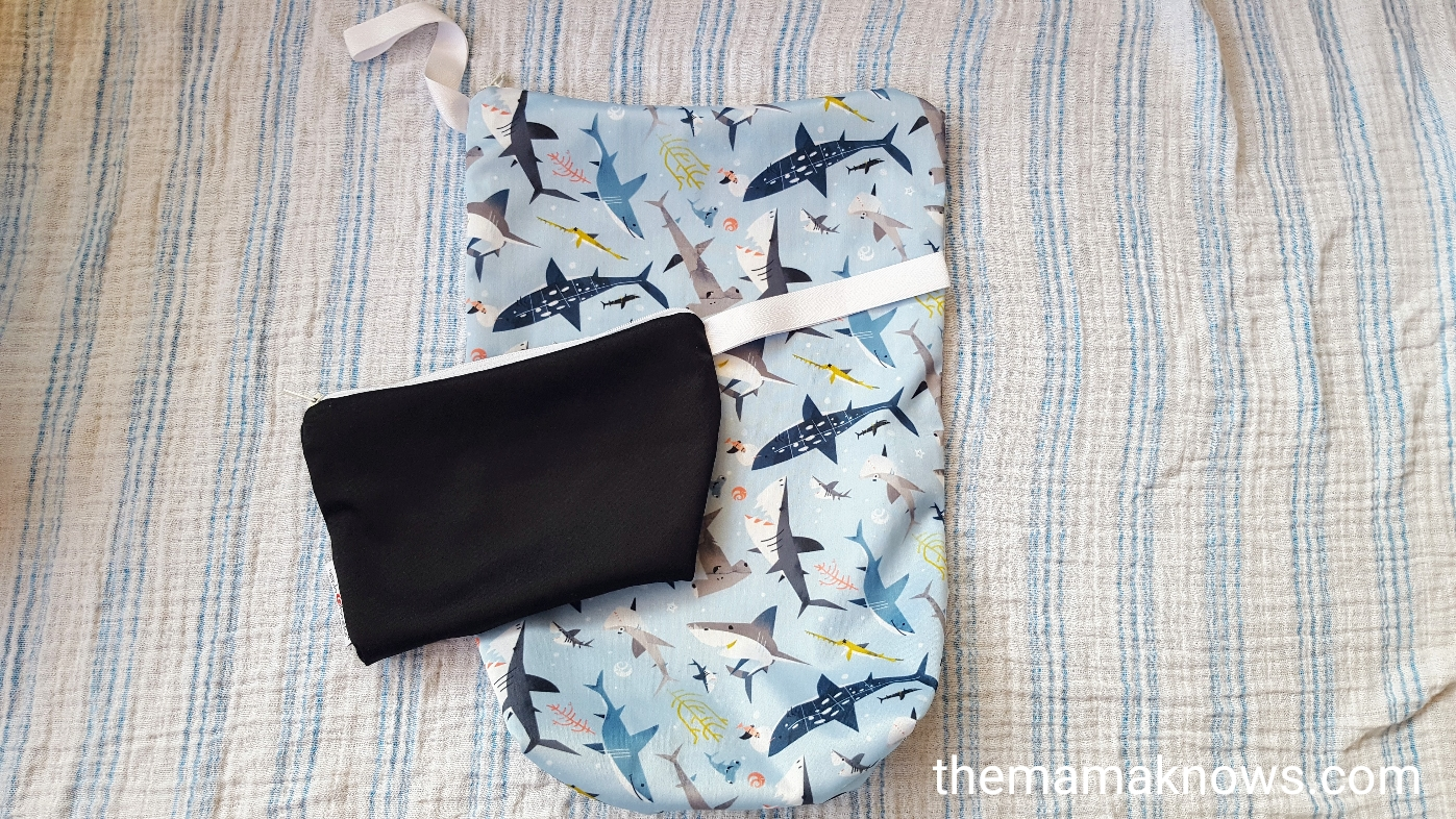 The AppleCheeks Size 1 wet bag and Minizip for cloth diapering on the go