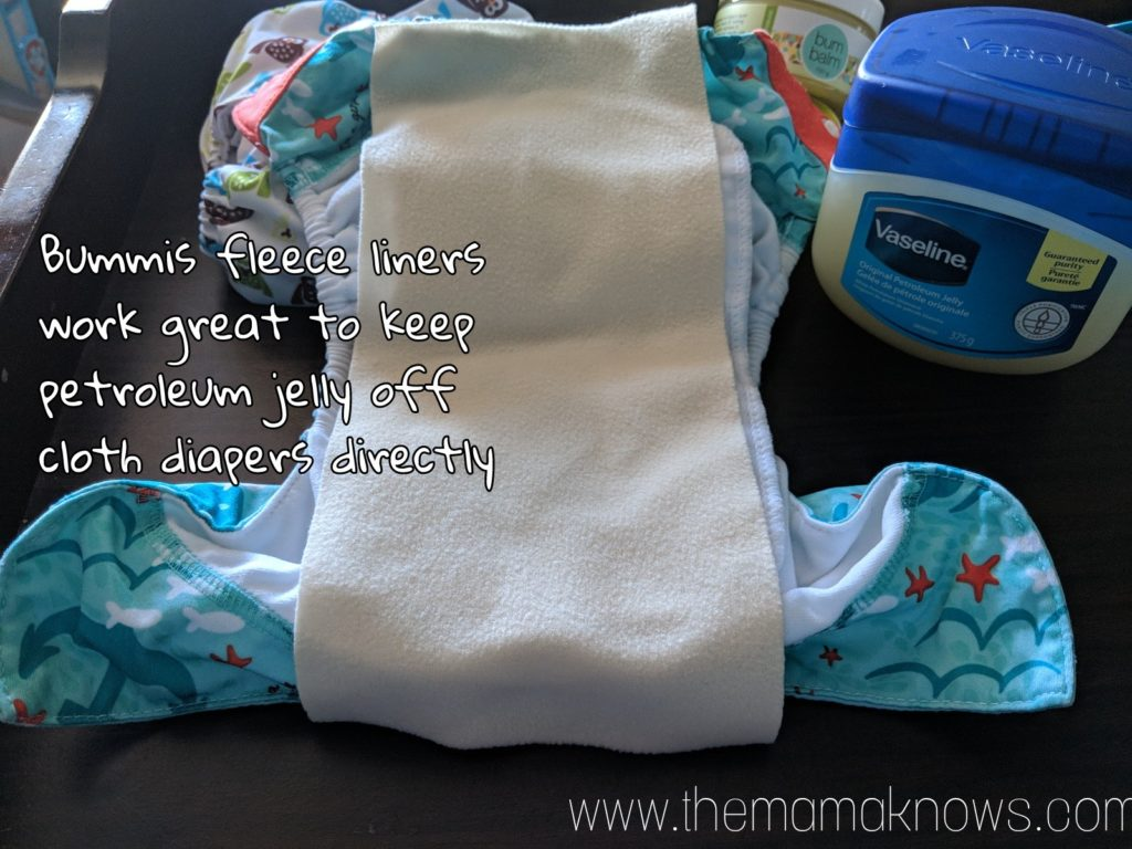 Use fleece liners like Bummis brand to keep Vaseline off of the cloth diapers directly.